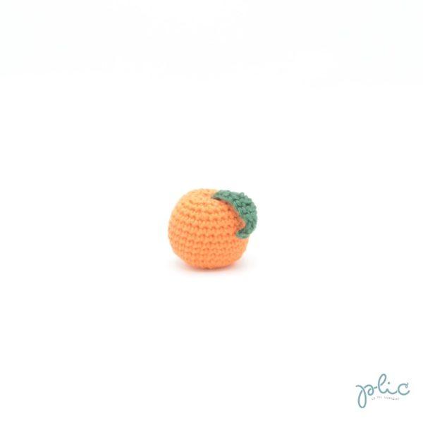 Petite boule de 3,5cm de diamètre avec feuille, le tout crocheté par Plic.