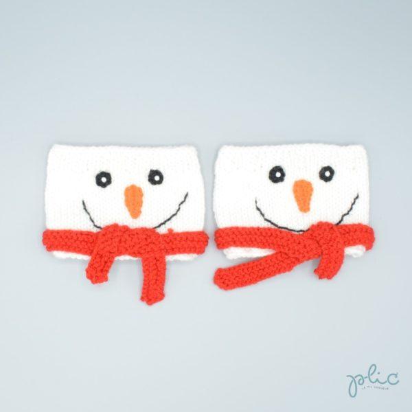 Bandes circulaires de 8cm de haut sur 11cm de large, réalisées au tricot par Plic et représentant la tête d'un bonhomme de neige.