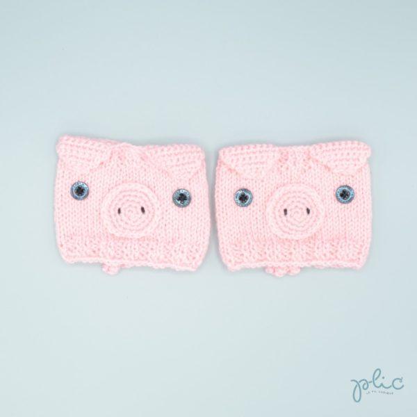 Bandes circulaires de 8cm de haut sur 11cm de large, réalisées au tricot par Plic et représentant la tête d'un cochon.